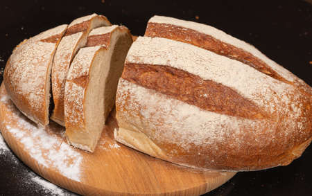 Fresh bread on the kitchen table, bakery or homemade baking concept.