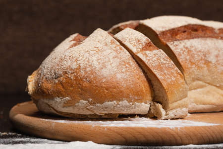 Healthy and tasty food. Fresh bread on a wooden board. Bakery products.