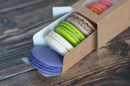 A cardboard box with macaroon cookies, a favorite treat for children