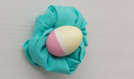Pastel colored Easter eggs on white table