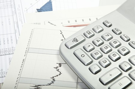 finacial: Desktop Calculator Closeup with diagrams and charts in the backgroung Stock Photo