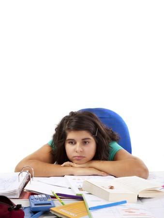 Young Teenage Girl is bored doing lot of Homework Stock Photo - 8910773