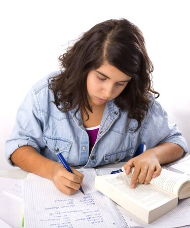 Young Teenage girl is working on her homework Stock Photo - 8910879