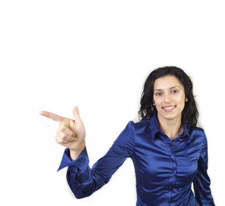 Portrait of happy young woman pointing with hand to the side photo