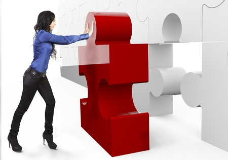Business Teamwork - businesswoman, builds or complets a big puzzle photo