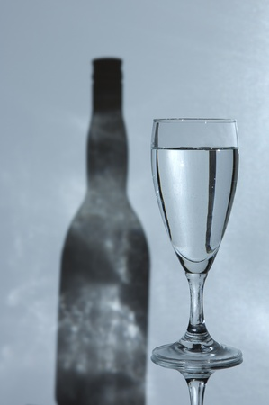 glas: Simple glas of water with a shadow of a bottle in the backgroun Stock Photo