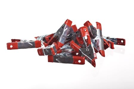 fixate: A buch of A-Clamps red and silver Stock Photo