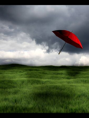 blown away: red umbrella blown away by wind Stock Photo