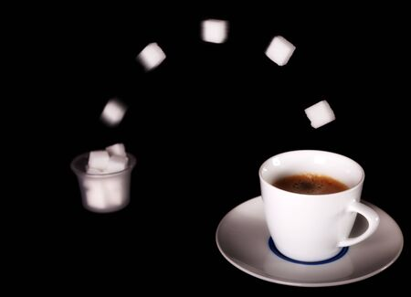 caffiene: Fresh Coffee with flying sugar Stock Photo