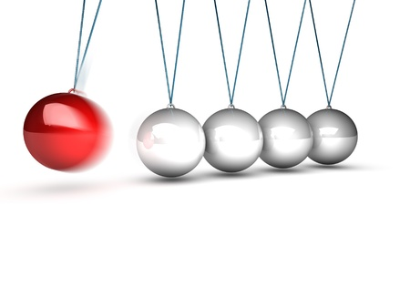 balancing balls newtons cradle over white background photo