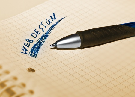 webdesgin on a college block with a pen Stock Photo - 12609336