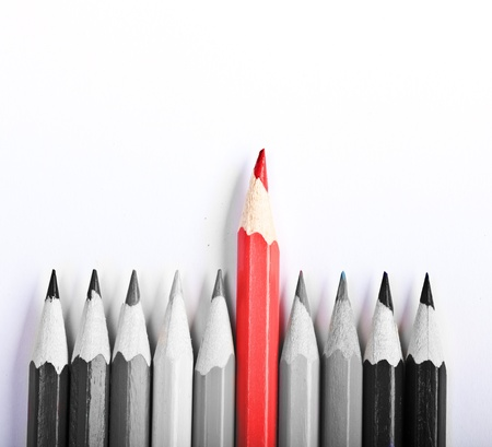 Red Pen standing out, over white background photo