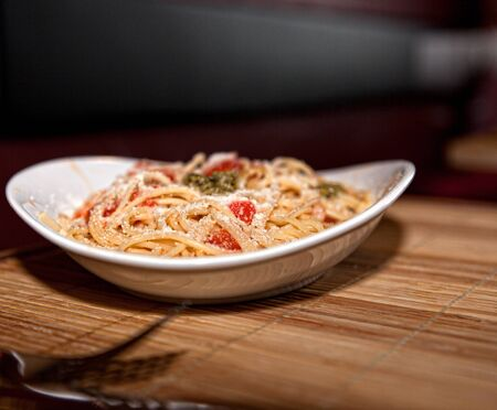 a of spaghetti on wooden table Stock Photo - 14979270