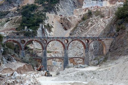 carrara: White marble quarry, bridge and excavators  Apuan, Carrara, Tusc
