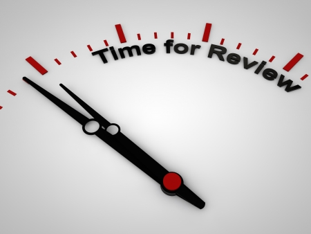 reviews: Time for review on a clock, one minute before twelve Stock Photo