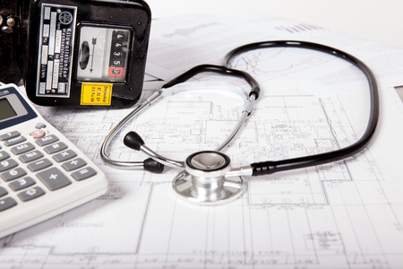 energy costs: Ananlyse energy costs with electric meter and stethoscope