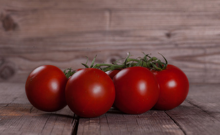 wooden table: red Tomatos on wooden table Stock Photo