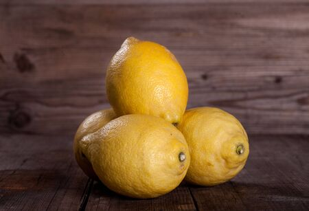yellow juicy Lemons on wooden tables