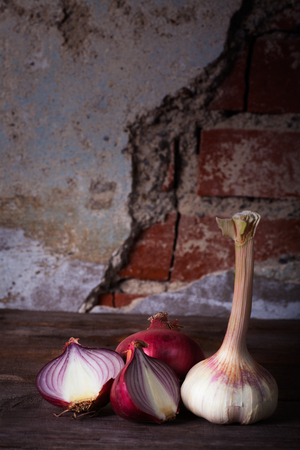 Onion and garlic on wooden table Stock Photo