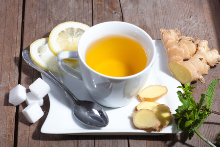 fresh natural Ginger Tea on wooden board Stock Photo