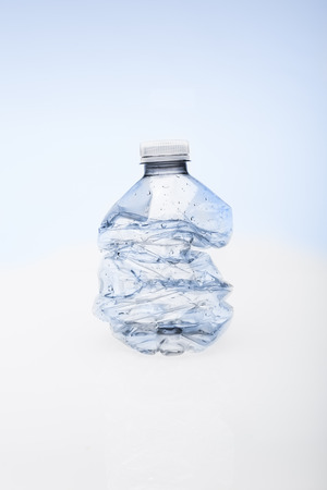 Crushed empty water bottle ready fro recycling. Banco de Imagens