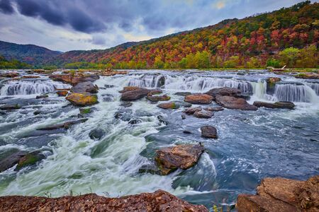 Sandstone Falls in West Virginia with fall colors.