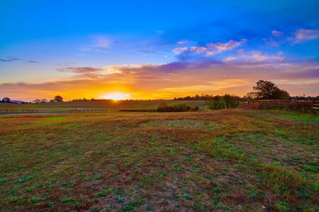 Sunrise over an open field.