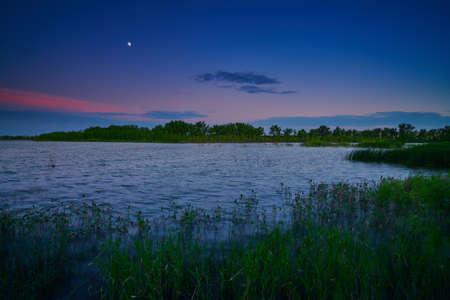 Moonrise over Oliver Reserve in Kimball, Nebraska.