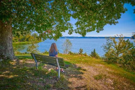 Women sitting on a bench enjoying the scenery of Kentucky Lake.