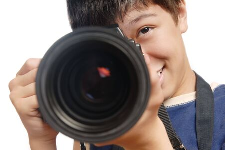 Photo of  smiling boy with digital camera and big lens