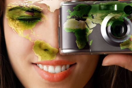 Smiling model with global map on her face making a photo using digital camera Standard-Bild