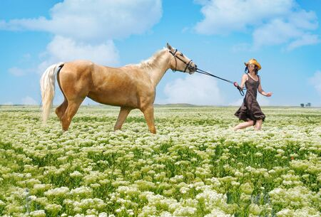 Photo of the running horsewoman and horse in summer field