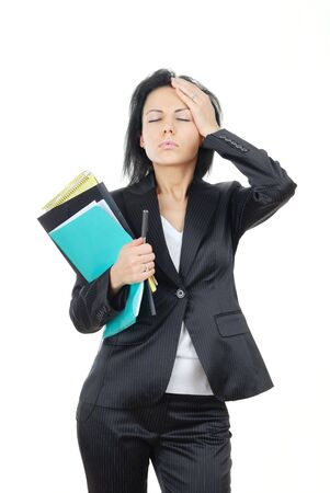 Thinking businesswoman with documents and pen and suffering from the headache