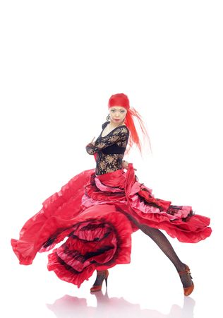 Lady in Gypsy costume dancing flamenco on a white background