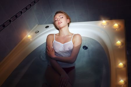 Lady relaxing in the spa bath-room with candle light Stock Photo - 4891914