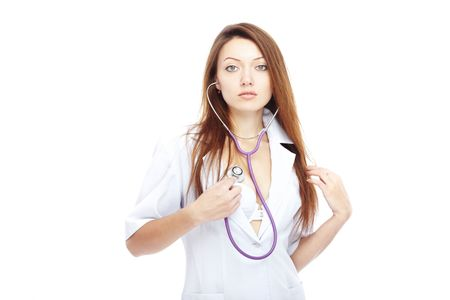Sexy lady on a white background revealing medical uniform and using stethoscope