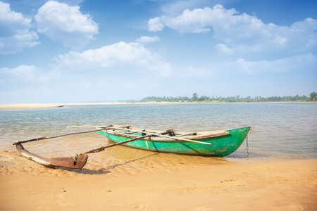 skiff: Old small boat at the tropical beach in India. Vibrant colors