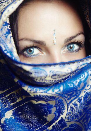 Close-up portrait of the female face in blue sari. Vertical photo Standard-Bild