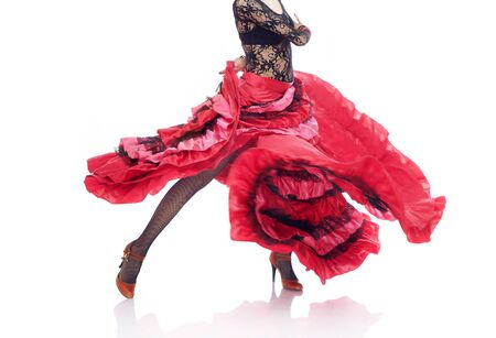 Unrecognizable lady in Gypsy costume dancing flamenco on a white background Standard-Bild