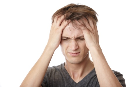 Young man feeling emotional stress and headache