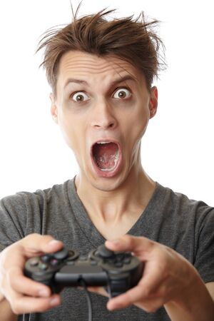 Crazy man in trouble playing video game using joystick Standard-Bild