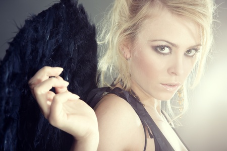 Portrait of the blond female angel with artificial wings Stock Photo - 10482081