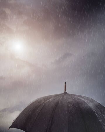 Wet umbrella under the rain