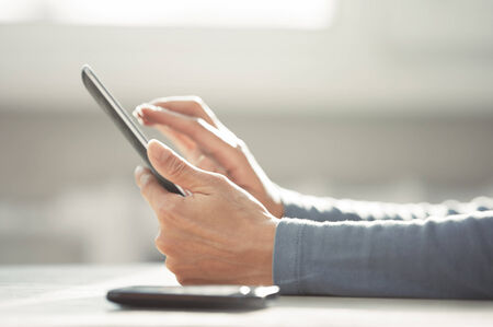 Hands of woman working with digital tablet