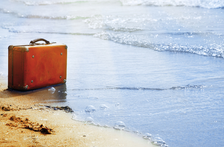 Lost orange handbag on the beach Imagens