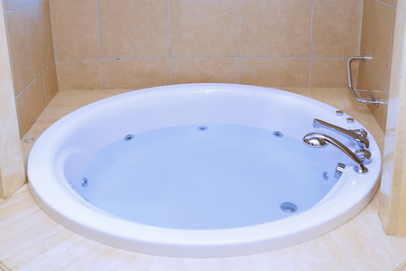 Modern bathtub full of water 免版税图像