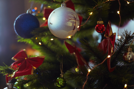 Decorated Christmas tree with light string. Close-up Stock Photo