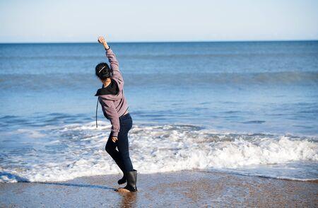 Happy woman having fun at the ocean
