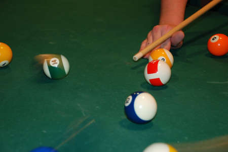 Photo of a billiard table together with spheres Stock Photo