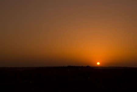 Photography of the sundown sun on field in daylight-savings time Stock Photo